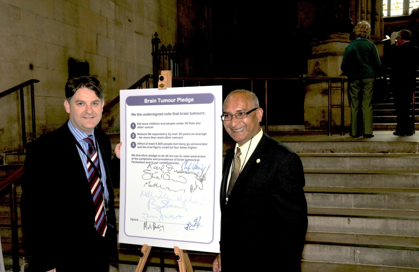 Philip with a constituent pledging support to Brain tumor research
