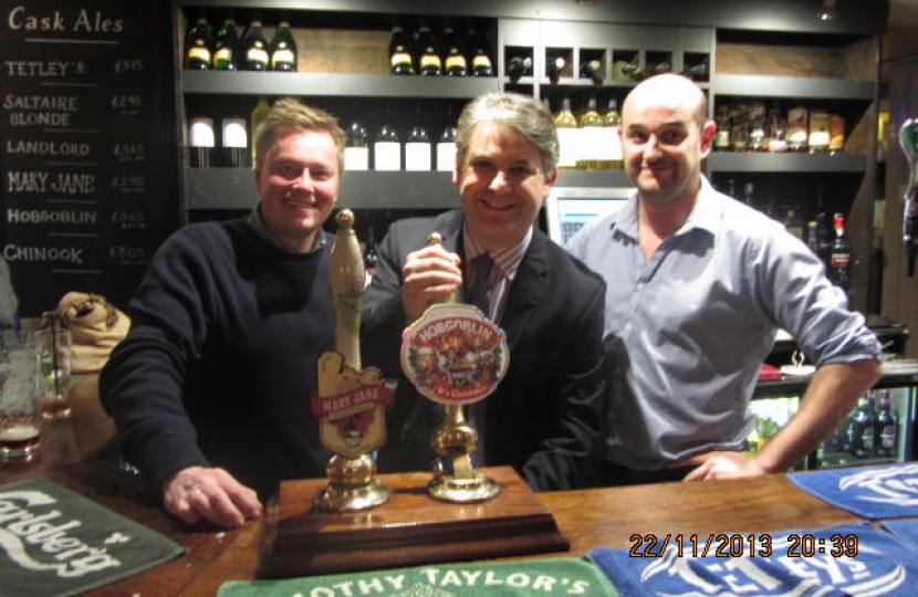 Philip (in the middle) at the Opening of Red Lion pub in Burley in Wharfedale